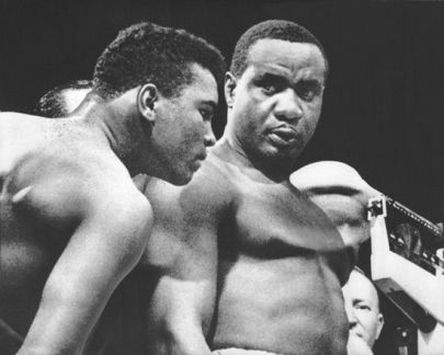 cassius-clay-sonny-liston-stare-weigh-in